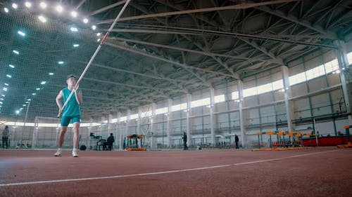 Pole Vaulting - Sportsman Is Rising a Long Pole and Running