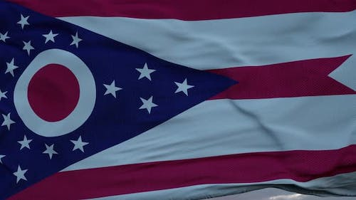 Flag of Ohio Waving in the Wind Against Deep Beautiful Clouds Sky