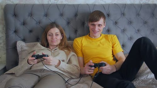 Woman And Man With Joysticks