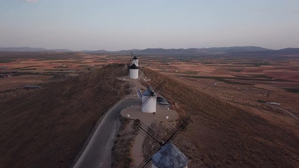 Windmills on Hill at Sunset in Consuegra, Mancha, Spain