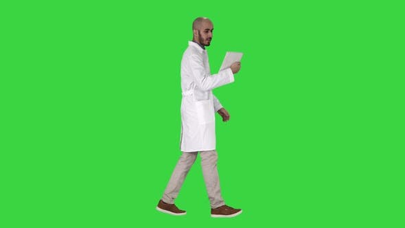 Thumbnail for Sincere Doctor Making Video Call To His Patient Walking on a Green Screen, Chroma Key