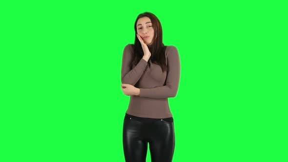 Thumbnail for Attractive Girl Throwing Up Hands Expressing She Is Innocent, Saying Oops She Doesn't Know What's
