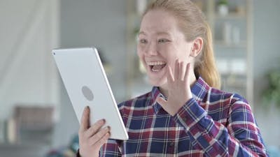 Young Woman Video Calling on Tablet