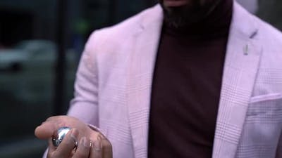 Portrait of a Bearded AfricanAmerican Man in a Pink Jacket