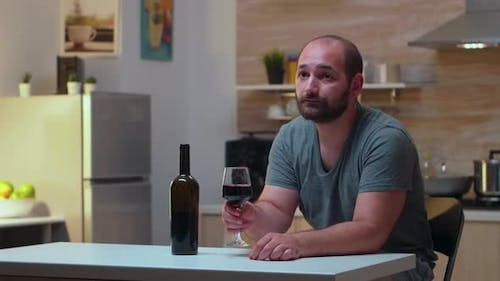 Lonely Husband Drinking a Glass of Wine