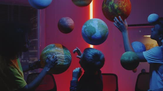 Teacher Explaining Astronomy To Students