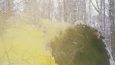Model in Phoenix Costume Walks Through Yellow Smoke Backside