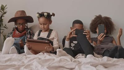 Kids in Halloween Costumes with Gadgets
