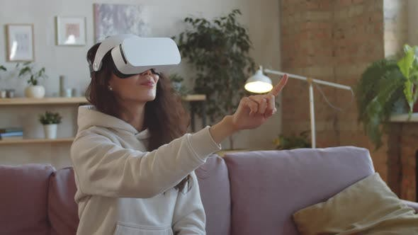 Woman in VR Headset Using Invisible Touchscreen