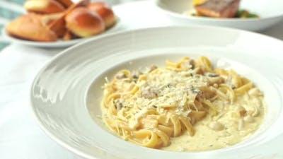 Spaghetti and pasta carbonara with sauce