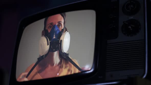 Thumbnail for Woman with Face Mask on a Retro Television.