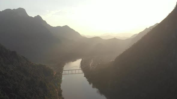 Thumbnail for Aerial: flying over Nam Ou River Nong Khiaw Muang Ngoi Laos, sunset mountain landscape