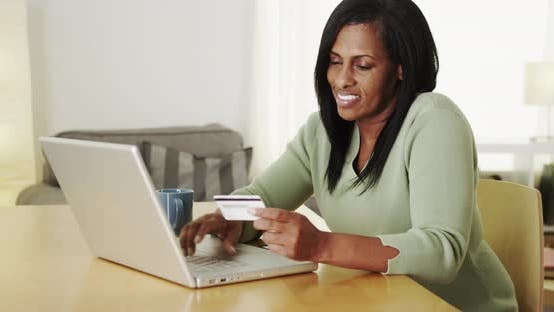 Thumbnail for Senior black woman shopping online laptop computer