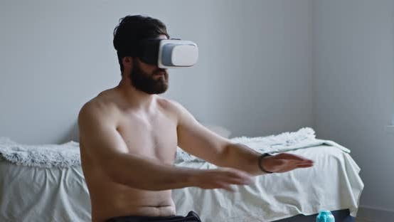 Thumbnail for Young Man Wearing VR Headset Exercising at Home Interior