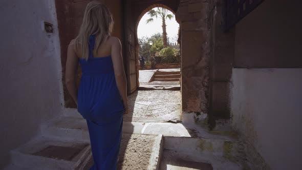 Thumbnail for Blond Woman In Blue Dress Walking In Rabat