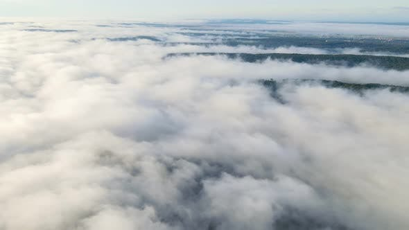 Thumbnail for Flight Over the Mountains and Forests Covered with a Magical Morning Mist. High Flight Over the Fog