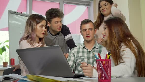 Thumbnail for Group of College Friends Laughing and Talking While Studying Together