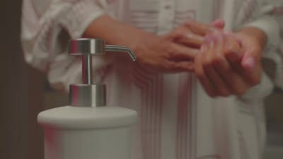 Close Up of African American Female Washing Her Hands with Soap