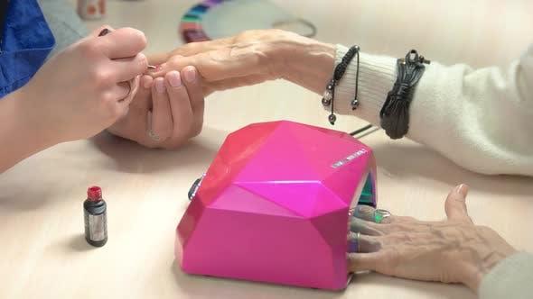 Process of Manicure in Beauty Salon.