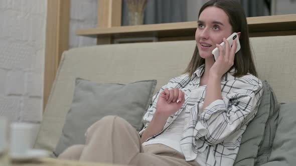 Thumbnail for Young Woman Talking on Smartphone in Living Room