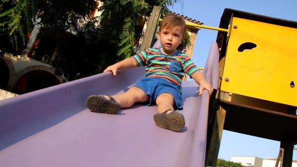 Thumbnail for Baby Toddler on the Park Slide 01