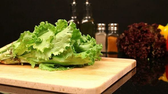 Thumbnail for Lettuce and Parsley Fall On A Cutting Board