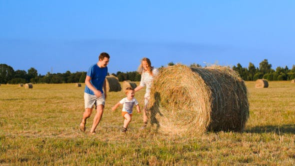 Thumbnail for Parents And Son Playing Together In The Field