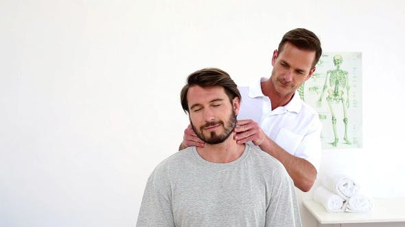 Thumbnail for Physiotherapist Touching Patients Injured Neck