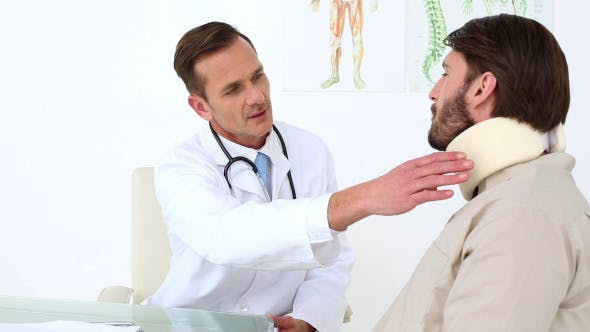 Thumbnail for Doctor Checking His Patient In A Neck Brace