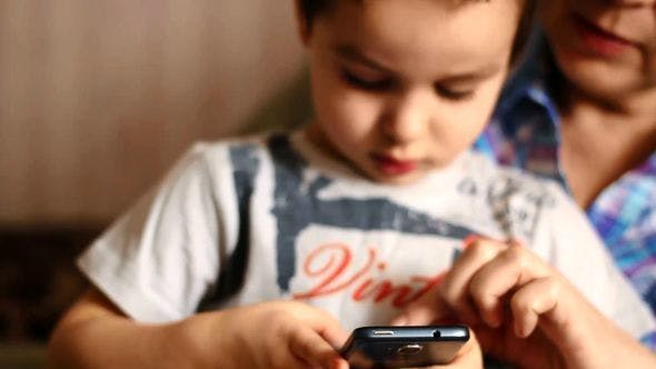 Thumbnail for Child Playing With A Smartphone