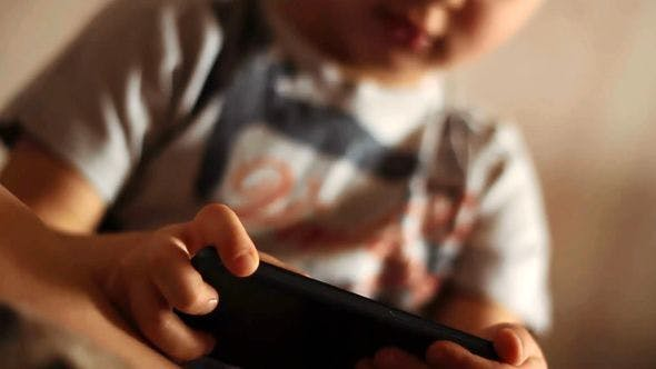 Thumbnail for Portrait Of A Child Playing With A Smartphone