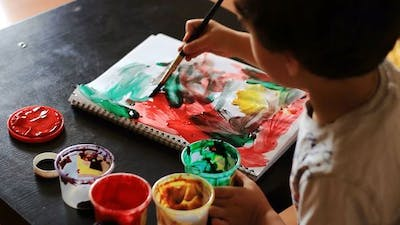 Boy Draws Paints Abstract Drawing