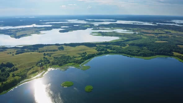 Thumbnail for Aerial View Amazing Lake Land with Picturesque Islands Covered with Green Trees and Meadows in