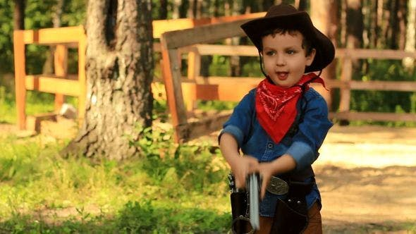 Thumbnail for Little Cowboy Playing With A Toy Gun