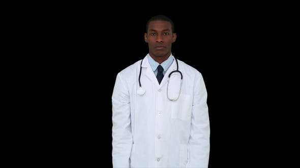 Thumbnail for Serious Young Doctor Showing Tablets To Camera 1