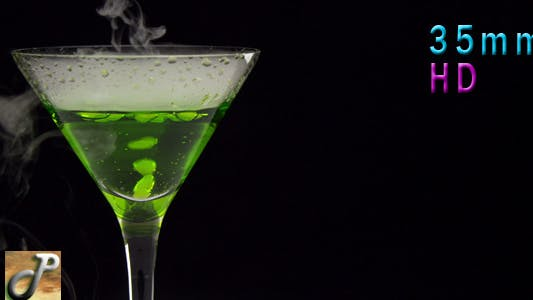 Thumbnail for Green Cocktail In Martini Glass And Side Move