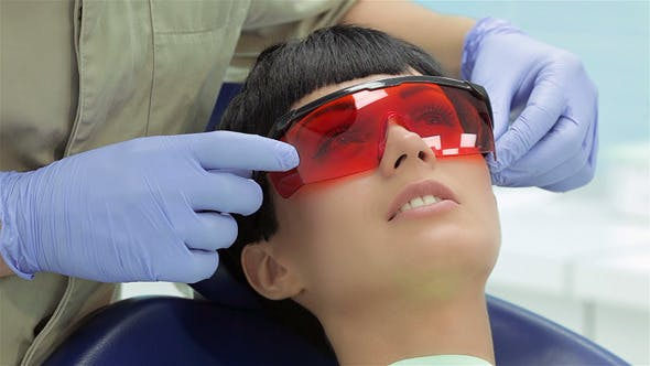 Thumbnail for Girl In Dental Chair With Protective Red Glasses