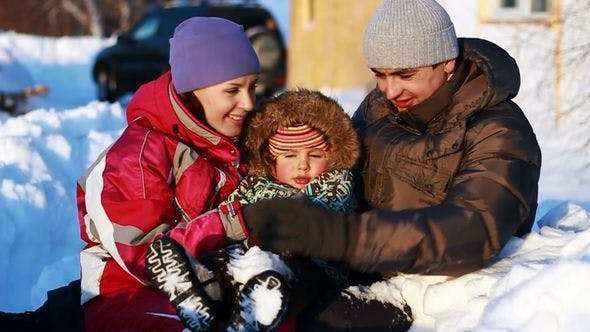 Thumbnail for Happy Couple With A Child In Winter