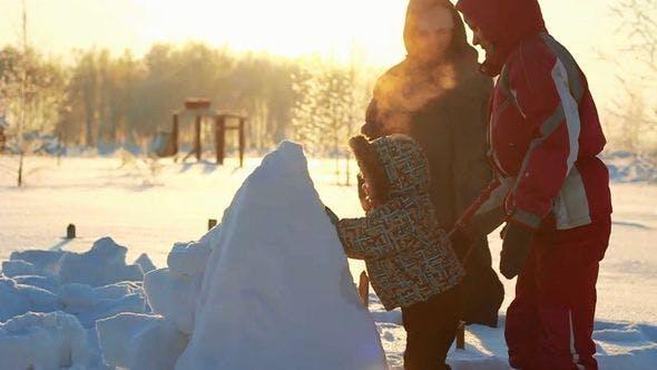 Thumbnail for Child Tries To Climb A Snowy Pyramid