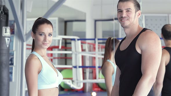 Thumbnail for Girl With Her Fitness Trainer In Boxing Hall