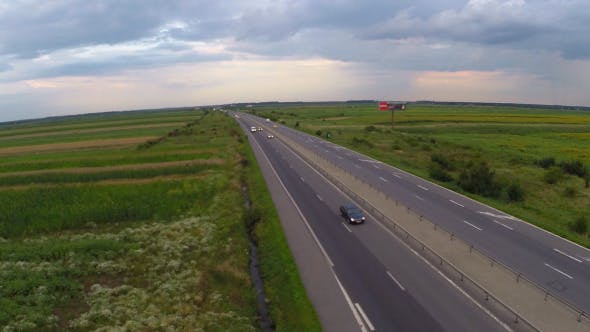 Thumbnail for Aerial View Of Highway Surrounded By Fields 2