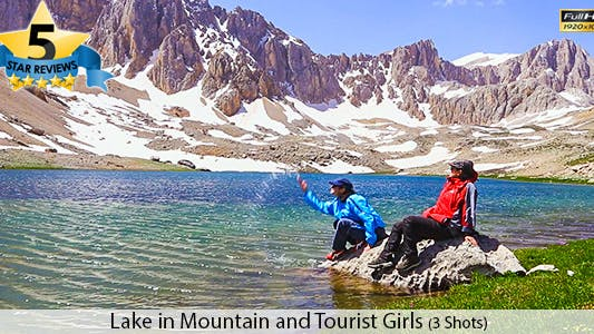 Cover Image for Two Girls Sitting Near The Mountain Lake