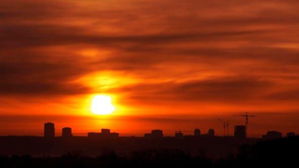 Thumbnail for Sunrise Over Far Town