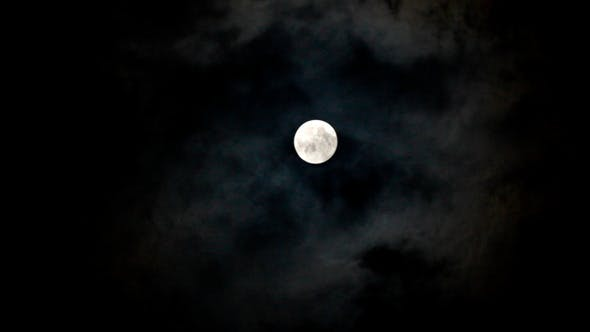 Thumbnail for Moon Moving Between Clouds