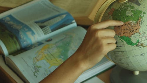 The Girl is Studying The Atlas