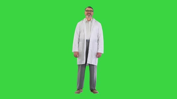 Senior Doctor Standing and Smiling To Camera on a Green Screen Chroma Key