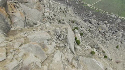 Descent from rocky cliff