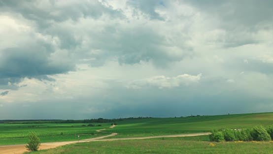 Thumbnail for Rural Fields with the Movement of Clouds Above Them