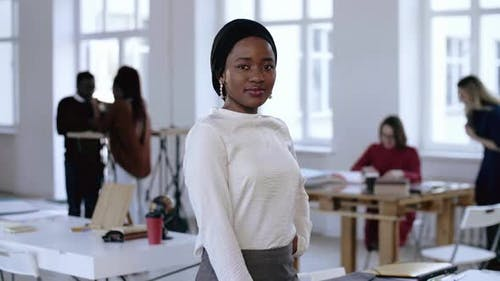 Happy Professional Young African Business Woman in Formal Clothes and Turban Posing, Smiling at