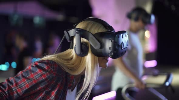 Modern Interactive Technologies, Female in Glasses of Virtual Reality Playing a Arcade Game.